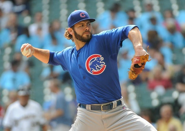 Sep 19, 2013; Milwaukee, WI, USA;  Chicago Cubs pitcher Jake Arrieta pitches against the Milwaukee Brewers in the first inning at Miller Park. Mandatory Credit: Benny Sieu-USA TODAY Sports