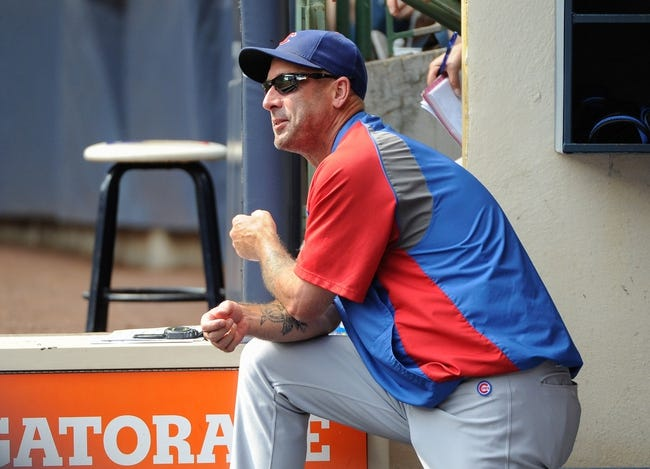 Sep 19, 2013; Milwaukee, WI, USA;   Chicago Cubs manager Dale Sveum watches game against the Milwaukee Brewers from the dugout in the second inning at Miller Park. Mandatory Credit: Benny Sieu-USA TODAY Sports