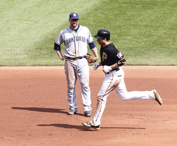 Sep 19, 2013; Pittsburgh, PA, USA; San Diego Padres third baseman Chase Headley (7) reacts as Pittsburgh Pirates second baseman Neil Walker (18) rounds the bases after hitting a two run home run during the fourth inning at PNC Park. Mandatory Credit: Charles LeClaire-USA TODAY Sports