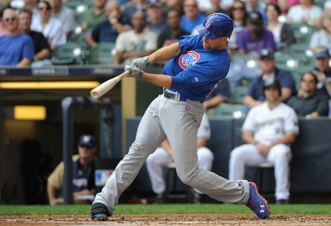 Sep 19, 2013; Milwaukee, WI, USA;   Chicago Cubs right fielder Nate Schierholtz hits a 2-run home run in the third inning against the Milwaukee Brewers at Miller Park. Mandatory Credit: Benny Sieu-USA TODAY Sports