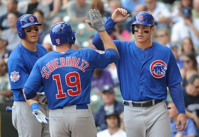 Sep 19, 2013; Milwaukee, WI, USA;   Chicago Cubs right fielder Nate Schierholtz (center) is greeted by center fielder Ryan Sweeney (left) and first baseman Anthony Rizzo (right) after hitting a 2-run homer in the third inning against the Milwaukee Brewers at Miller Park. Mandatory Credit: Benny Sieu-USA TODAY Sports