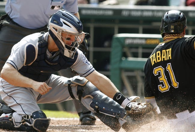 Sep 19, 2013; Pittsburgh, PA, USA; San Diego Padres catcher Nick Hundley (left) tags out Pittsburgh Pirates right fielder Jose Tabata (31) at home plate during the sixth inning at PNC Park. Mandatory Credit: Charles LeClaire-USA TODAY Sports