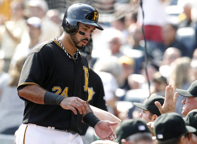 Sep 19, 2013; Pittsburgh, PA, USA; Pittsburgh Pirates third baseman Pedro Alvarez (24) is greeted at the dugout after scoring a run against the San Diego Padres during the seventh inning at PNC Park. The Pittsburgh Pirates won 10-1. Mandatory Credit: Charles LeClaire-USA TODAY Sports
