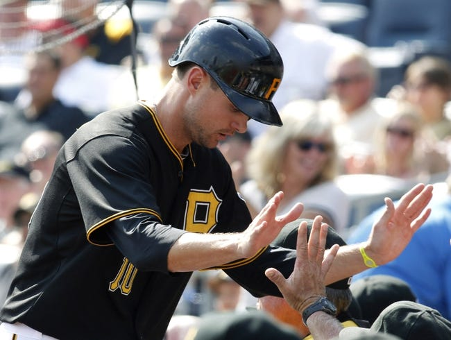 Sep 19, 2013; Pittsburgh, PA, USA; Pittsburgh Pirates shortstop Jordy Mercer (10) is greeted at the dugout after scoring a run against the San Diego Padres during the seventh inning at PNC Park. The Pittsburgh Pirates won 10-1. Mandatory Credit: Charles LeClaire-USA TODAY Sports
