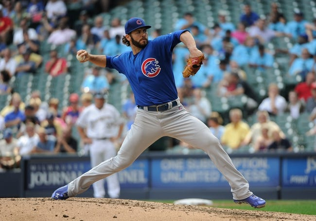 Sep 19, 2013; Milwaukee, WI, USA;  Chicago Cubs pitcher Jake Arrieta pitches in the fifth inning against the Milwaukee Brewers at Miller Park. Mandatory Credit: Benny Sieu-USA TODAY Sports