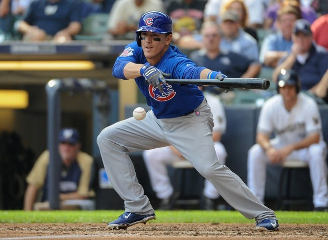 Sep 19, 2013; Milwaukee, WI, USA;  Chicago Cubs second baseman Logan Watkins bunts for a base hit in the sixth inning against the Milwaukee Brewers at Miller Park. Mandatory Credit: Benny Sieu-USA TODAY Sports