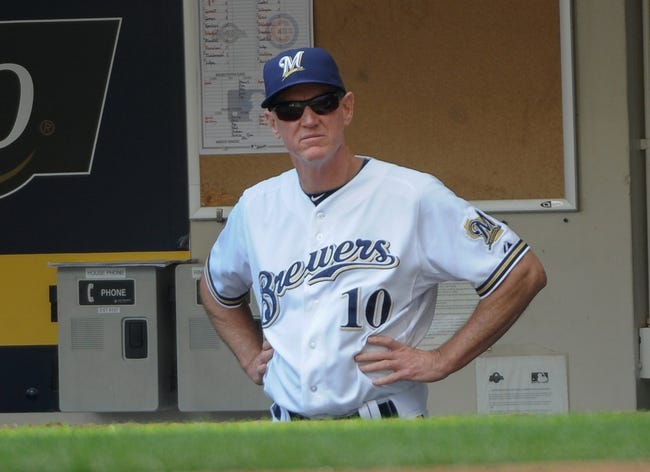Sep 19, 2013; Milwaukee, WI, USA;  Milwaukee Brewers manager Ron Roenicke watches game against the Chicago Cubs from the dugout in the fifth inning at Miller Park. Mandatory Credit: Benny Sieu-USA TODAY Sports