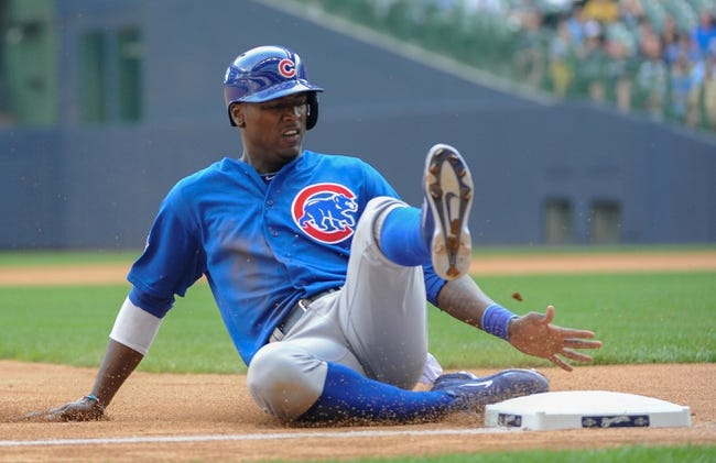 Sep 19, 2013; Milwaukee, WI, USA;   Chicago Cubs left fielder Junior Lake advances to third base on an error by Milwaukee Brewers pitcher Burke Badenhop (not pictured) in the sixth inning at Miller Park. Mandatory Credit: Benny Sieu-USA TODAY Sports