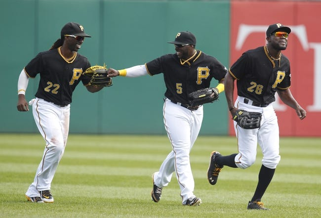 Sep 19, 2013; Pittsburgh, PA, USA; Pittsburgh Pirates center fielder Andrew McCutchen (22) and Pittsburgh Pirates right fielder Josh Harrison (5) and left fielder Felix Pie (26) react after defeating the San Diego Padres at PNC Park. The Pittsburgh Pirates won 10-1. Mandatory Credit: Charles LeClaire-USA TODAY Sports