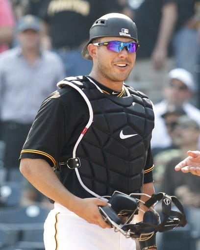 Sep 19, 2013; Pittsburgh, PA, USA; Pittsburgh Pirates catcher Tony Sanchez (59) reacts after tumbling into the San Diego Padres dugout to record an out during the eighth inning at PNC Park. The Pittsburgh Pirates won 10-1. Mandatory Credit: Charles LeClaire-USA TODAY Sports