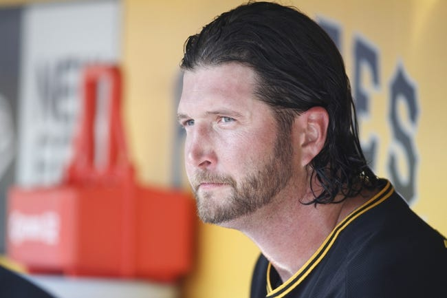 Sep 19, 2013; Pittsburgh, PA, USA; Pittsburgh Pirates relief pitcher Jason Grilli (39) looks on from the dugout after pitching the eighth inning against the San Diego Padres at PNC Park. The Pittsburgh Pirates won 10-1. Mandatory Credit: Charles LeClaire-USA TODAY Sports