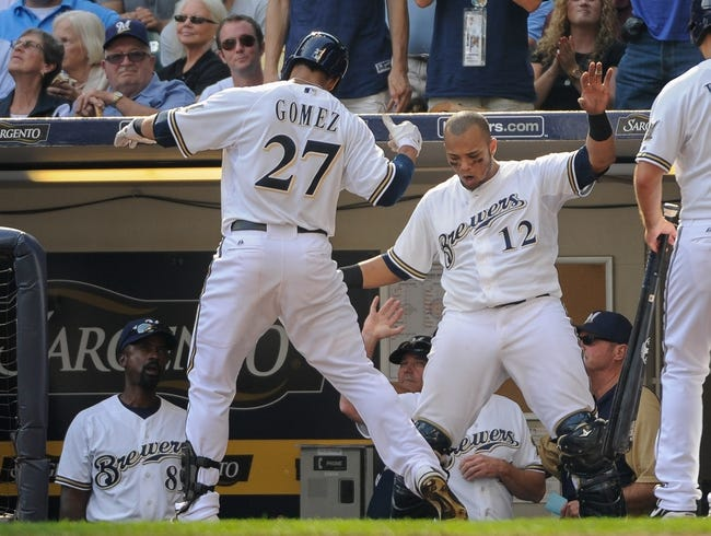 Sep 19, 2013; Milwaukee, WI, USA;  Milwaukee Brewers center fielder Carlos Gomez (27) celebrates with catcher Martin Maldonado (12) after hitting a solo homer in the seventh inning against the Chicago Cubs at Miller Park. Mandatory Credit: Benny Sieu-USA TODAY Sports