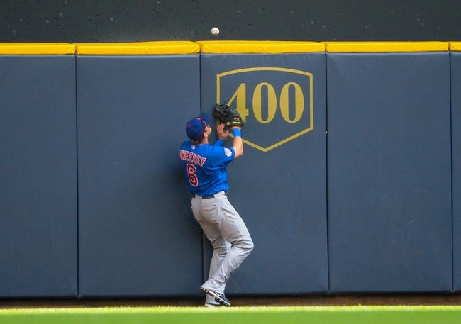 Sep 19, 2013; Milwaukee, WI, USA;   Chicago Cubs center fielder Ryan Sweeney can't catch ball hit by Milwaukee Brewers center fielder Carlos Gomez (not pictured) for a home run in the seventh inning at Miller Park. Mandatory Credit: Benny Sieu-USA TODAY Sports