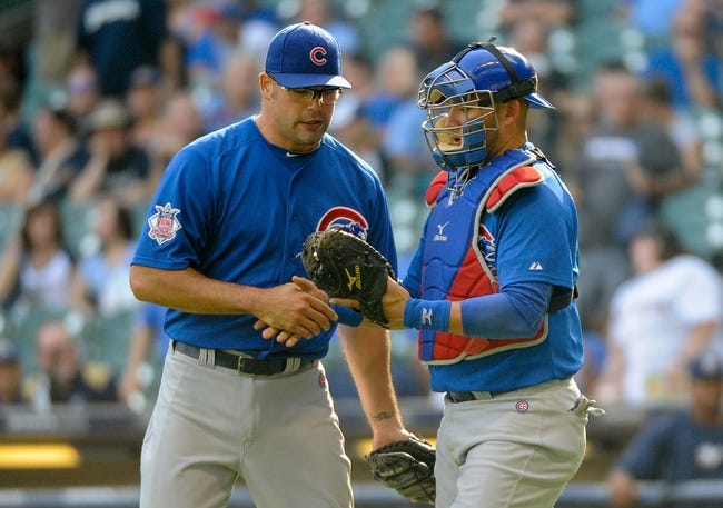 Sep 19, 2013; Milwaukee, WI, USA;   Chicago Cubs pitcher Kevin Gregg (left) and catcher J.C. Boscan (right) celebrate after beating the Milwaukee Brewers 5-1 at Miller Park. Mandatory Credit: Benny Sieu-USA TODAY Sports