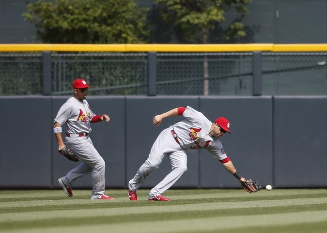 Sep 19, 2013; Denver, CO, USA; St. Louis Cardinals right fielder Carlos Beltran (3) fails to field a fly ball during the second inning against the Colorado Rockies at Coors Field. Mandatory Credit: Chris Humphreys-USA TODAY Sports