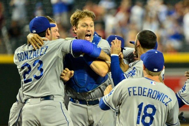 Sep 19, 2013; Phoenix, AZ, USA; Los Angeles Dodgers catcher A.J. Ellis (center) celebrates after beating the Arizona Diamondbacks 7-6 at Chase Field. Mandatory Credit: Matt Kartozian-USA TODAY Sports