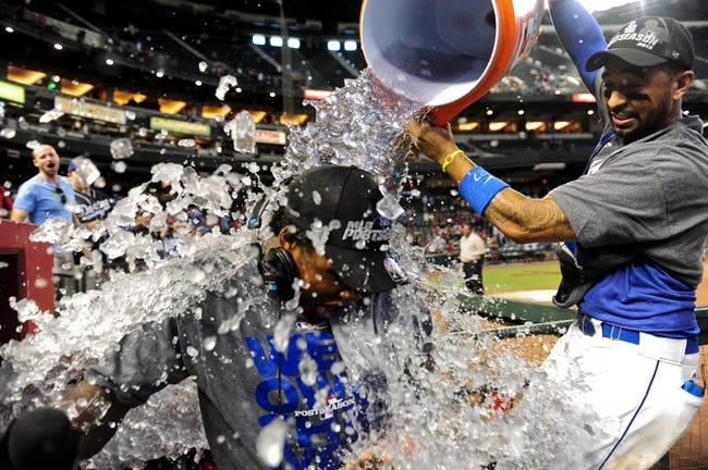 Sep 19, 2013; Phoenix, AZ, USA; Los Angeles Dodgers center fielder Matt Kemp (27) pours gatorade on shortstop Hanley Ramirez (13) in celebration after beating the Arizona Diamondbacks 7-6 at Chase Field. Mandatory Credit: Matt Kartozian-USA TODAY Sports