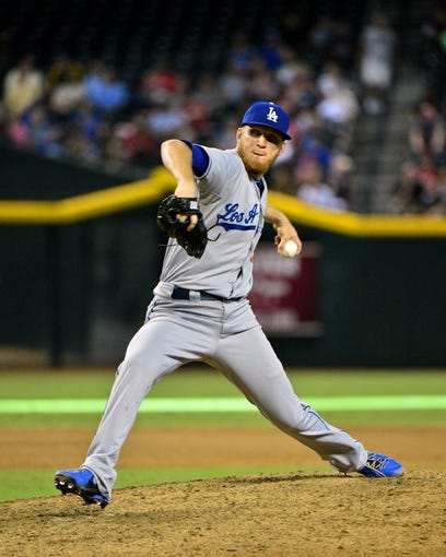 Sep 19, 2013; Phoenix, AZ, USA; Los Angeles Dodgers relief pitcher J.P. Howell (56) throws during the seventh inning against the Arizona Diamondbacks at Chase Field. Mandatory Credit: Matt Kartozian-USA TODAY Sports