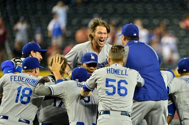 Sep 19, 2013; Phoenix, AZ, USA; Los Angeles Dodgers pitcher Clayton Kershaw (center, top) celebrates after beating the Arizona Diamondbacks 7-6 at Chase Field. Mandatory Credit: Matt Kartozian-USA TODAY Sports