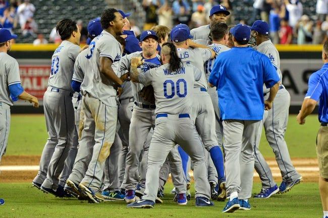 Sep 19, 2013; Phoenix, AZ, USA; Members of the Los Angeles Dodgers celebrate after beating the Arizona Diamondbacks 7-6 at Chase Field. Mandatory Credit: Matt Kartozian-USA TODAY Sports