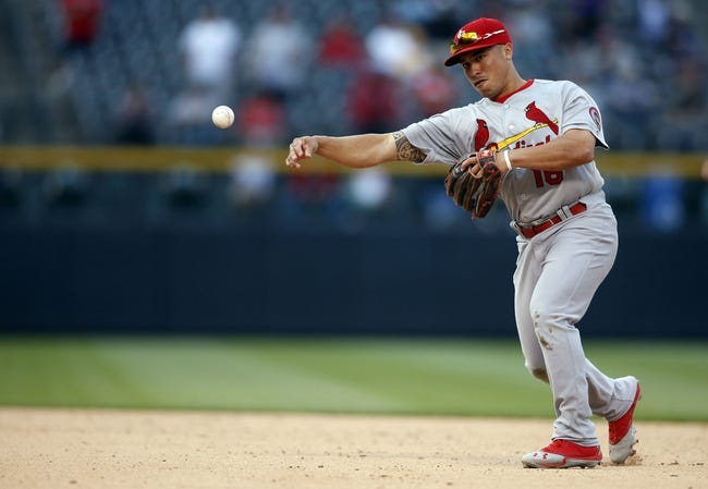 Sep 19, 2013; Denver, CO, USA; St. Louis Cardinals second baseman Kolten Wong (16) fields a ground ball during the fourteenth inning against the Colorado Rockies at Coors Field. The Rockies won 7-6 in 15 innings.  Mandatory Credit: Chris Humphreys-USA TODAY Sports