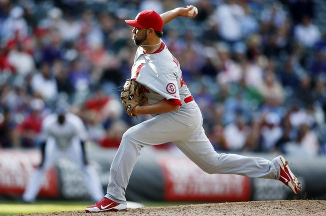 Sep 19, 2013; Denver, CO, USA; St. Louis Cardinals pitcher Edward Mujica (44) delivers a pitch during the ninth inning against the Colorado Rockies at Coors Field. The Rockies won 7-6 in 15 innings.  Mandatory Credit: Chris Humphreys-USA TODAY Sports