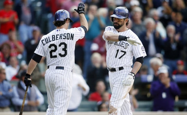 Sep 19, 2013; Denver, CO, USA; Colorado Rockies first baseman Todd Helton (17) celebrates with left fielder Charlie Culberson (23) after hitting a game tying home run during the ninth inning against the St. Louis Cardinals at Coors Field. The Rockies won 7-6 in 15 innings.  Mandatory Credit: Chris Humphreys-USA TODAY Sports