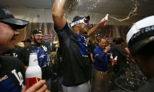 Sep 19, 2013; Phoenix, AZ, USA; Los Angeles Dodgers relief pitcher Kenley Jansen (74) celebrates in the clubhouse after defeating the Arizona Diamondbacks 7-6 to clinch the NL West title at Chase Field. Mandatory Credit: Rob Schumacher/The Arizona Republic-USA TODAY Sports