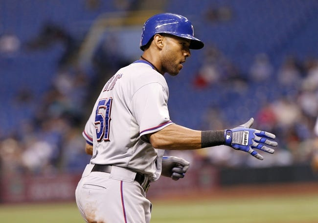 Sep 19, 2013; St. Petersburg, FL, USA; Texas Rangers right fielder Alex Rios (51) high fives as he runs around the bases after he hit a solo home run against the Tampa Bay Rays bat Tropicana Field. Mandatory Credit: Kim Klement-USA TODAY Sports