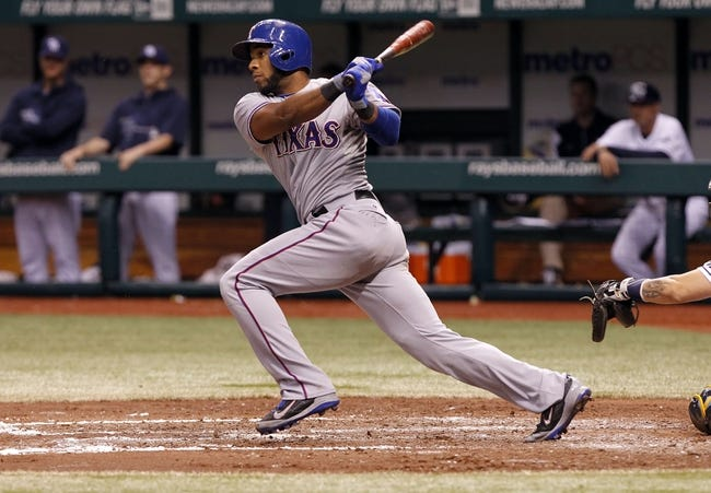 Sep 19, 2013; St. Petersburg, FL, USA; Texas Rangers shortstop Elvis Andrus (1) hits a RBI single during the fourth inning against the Tampa Bay Rays at Tropicana Field. Mandatory Credit: Kim Klement-USA TODAY Sports
