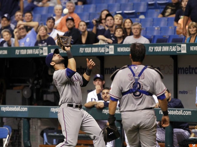 Sep 19, 2013; St. Petersburg, FL, USA; Texas Rangers first baseman Mitch Moreland (18) catches a foul ball during the ninth inning against the Tampa Bay Rays at Tropicana Field. Texas Rangers defeated the Tampa Bay Rays 8-2. Mandatory Credit: Kim Klement-USA TODAY Sports