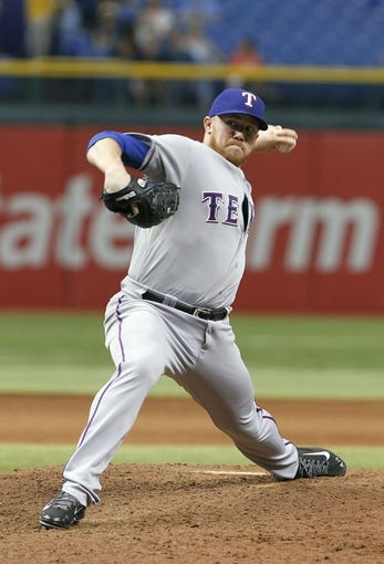 Sep 19, 2013; St. Petersburg, FL, USA; Texas Rangers relief pitcher Robbie Ross (46) throws a pitch during the seventh inning against the Tampa Bay Rays at Tropicana Field. Texas Rangers defeated the Tampa Bay Rays 8-2. Mandatory Credit: Kim Klement-USA TODAY Sports