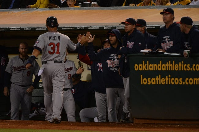 September 19, 2013; Oakland, CA, USA; Minnesota Twins right fielder Oswaldo Arcia (31) is congratulate for scoring on a RBI-single by catcher Josmil Pinto (43, not pictured) against the Oakland Athletics during the sixth inning at O.co Coliseum. Mandatory Credit: Kyle Terada-USA TODAY Sports