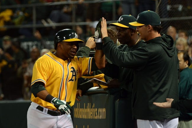 September 19, 2013; Oakland, CA, USA; Oakland Athletics second baseman Alberto Callaspo (18) is congratulated for hitting a solo home run against the Minnesota Twins during the sixth inning at O.co Coliseum. Mandatory Credit: Kyle Terada-USA TODAY Sports
