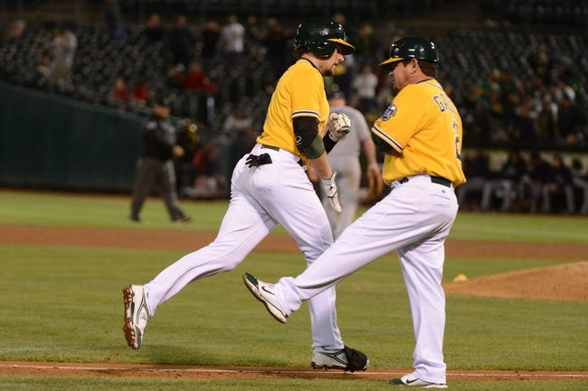 September 19, 2013; Oakland, CA, USA; Oakland Athletics shortstop Jed Lowrie (8, left) is congratulated by third base coach Mike Gallego (2) for hitting a three-run home run against the Minnesota Twins during the sixth inning at O.co Coliseum. Mandatory Credit: Kyle Terada-USA TODAY Sports