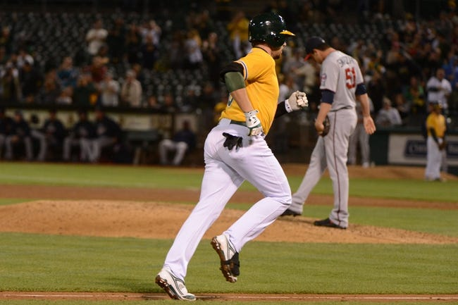 September 19, 2013; Oakland, CA, USA; Oakland Athletics shortstop Jed Lowrie (8, left) rounds the bases after hitting a three-run home run off of Minnesota Twins relief pitcher Anthony Swarzak (51) during the sixth inning at O.co Coliseum. Mandatory Credit: Kyle Terada-USA TODAY Sports