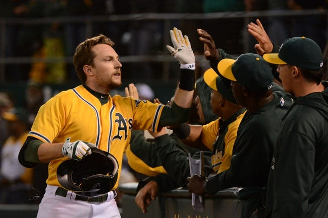 September 19, 2013; Oakland, CA, USA; Oakland Athletics shortstop Jed Lowrie (8, left) is congratulated for hitting a three-run home run against the Minnesota Twins during the sixth inning at O.co Coliseum. Mandatory Credit: Kyle Terada-USA TODAY Sports