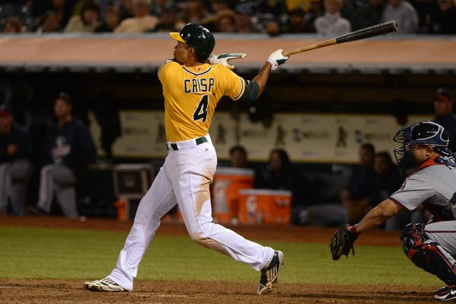 September 19, 2013; Oakland, CA, USA; Oakland Athletics center fielder Coco Crisp (4) hits a two-run home run against the Minnesota Twins during the eighth inning at O.co Coliseum. The Athletics defeated the Twins 8-6. Mandatory Credit: Kyle Terada-USA TODAY Sports