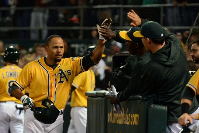 September 19, 2013; Oakland, CA, USA; Oakland Athletics center fielder Coco Crisp (4) is congratulated for hitting a two-run home run against the Minnesota Twins during the eighth inning at O.co Coliseum. The Athletics defeated the Twins 8-6. Mandatory Credit: Kyle Terada-USA TODAY Sports