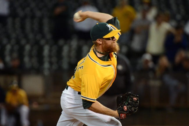 September 19, 2013; Oakland, CA, USA; Oakland Athletics relief pitcher Sean Doolittle (62) delivers a pitch against the Minnesota Twins during the ninth inning at O.co Coliseum. The Athletics defeated the Twins 8-6. Mandatory Credit: Kyle Terada-USA TODAY Sports
