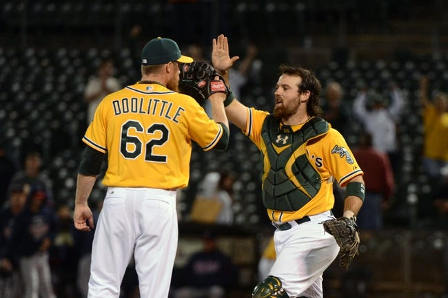 September 19, 2013; Oakland, CA, USA; Oakland Athletics relief pitcher Sean Doolittle (62) celebrates with catcher Derek Norris (36, right) after the game against the Minnesota Twins at O.co Coliseum. The Athletics defeated the Twins 8-6. Mandatory Credit: Kyle Terada-USA TODAY Sports