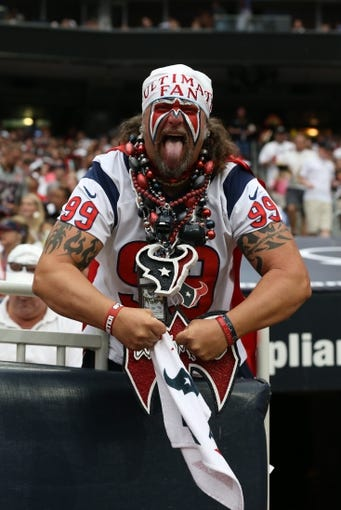 Sep 15, 2013; Houston, TX, USA; Houston Texans ultimate fan Steve Beckholt poses for a photo during the game against the Tennessee Titans at Reliant Stadium. Mandatory Credit: Matthew Emmons-USA TODAY Sports