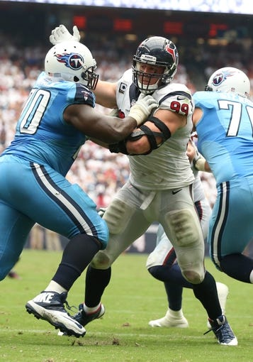Sep 15, 2013; Houston, TX, USA; Houston Texans defensive end J.J. Watt (99) in action against the Tennessee Titans at Reliant Stadium. Mandatory Credit: Matthew Emmons-USA TODAY Sports