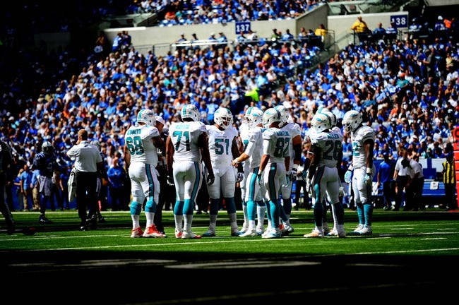 Sep 15, 2013; Indianapolis, IN, USA; Miami Dolphins offense huddle against the Indianapolis Colts at Lucas Oil Stadium. Mandatory Credit: Andrew Weber-USA TODAY Sports