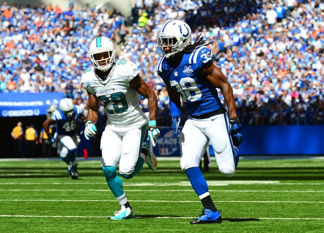 Sep 15, 2013; Indianapolis, IN, USA; Miami Dolphins cornerback Nolan Carroll (28) against Indianapolis Colts defensive back Sergio Brown (38) at Lucas Oil Stadium. Mandatory Credit: Andrew Weber-USA TODAY Sports
