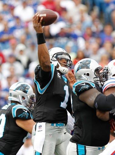 Sep 15, 2013; Orchard Park, NY, USA; Carolina Panthers quarterback Cam Newton (1) passes during the game against the Buffalo Bills at Ralph Wilson Stadium. Mandatory Credit: Kevin Hoffman-USA TODAY Sports