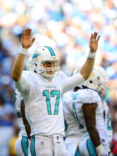 Sep 15, 2013; Indianapolis, IN, USA; Miami Dolphins quarterback Ryan Tannehill (17) against the Indianapolis Colts at Lucas Oil Stadium. Mandatory Credit: Andrew Weber-USA TODAY Sports