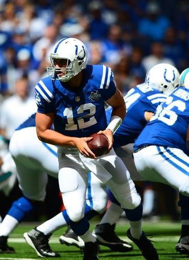 Sep 15, 2013; Indianapolis, IN, USA; Indianapolis Colts quarterback Andrew Luck (12) against the Miami Dolphins at Lucas Oil Stadium. Mandatory Credit: Andrew Weber-USA TODAY Sports