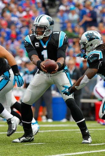 Sep 15, 2013; Orchard Park, NY, USA; Carolina Panthers quarterback Cam Newton (1) hands the ball off during a game against the Buffalo Bills at Ralph Wilson Stadium. Mandatory Credit: Timothy T. Ludwig-USA TODAY Sports