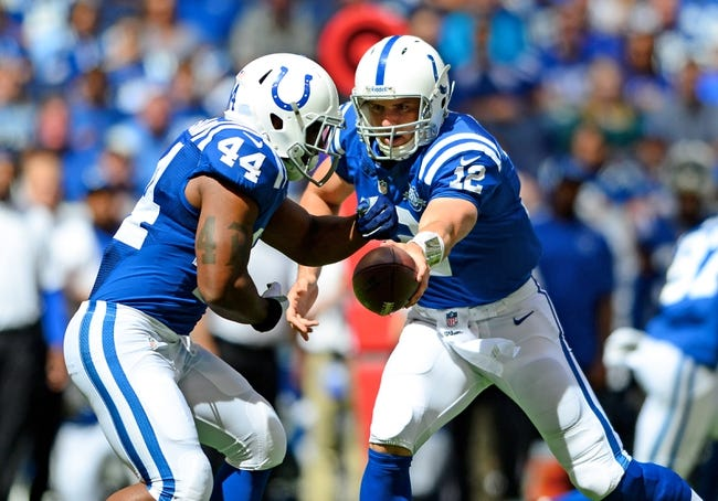 Sep 15, 2013; Indianapolis, IN, USA; Indianapolis Colts quarterback Andrew Luck (12) hands the ball off to running back Ahmad Bradshaw (44) against the Miami Dolphins at Lucas Oil Stadium. Mandatory Credit: Andrew Weber-USA TODAY Sports